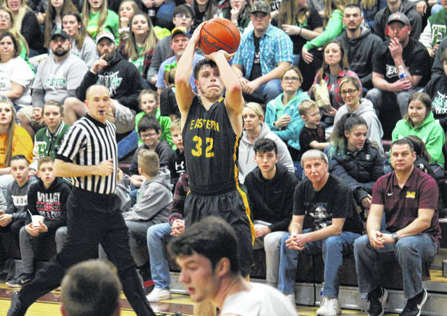 Eastern senior Isaiah Fish (32) hits a two-pointer in the second period of the Eagles' 63-50 setback in the D-4 sectional final on Tuesday in Rocksprings, Ohio.