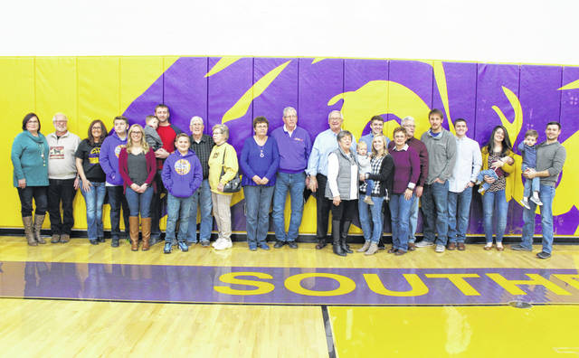 Southern Local Hall of Fame Class of 2019 inductees Gordon Fisher and Ronnie Salser are pictured with their families during at Friday's induction ceremony.