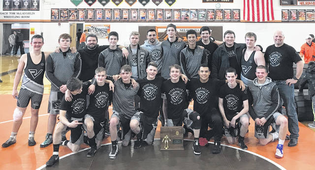 Members of the River Valley wrestling team pose for a picture after winning the Division III Region 22 team championship on Saturday at Nelsonville-York High School in Nelsonville, Ohio.