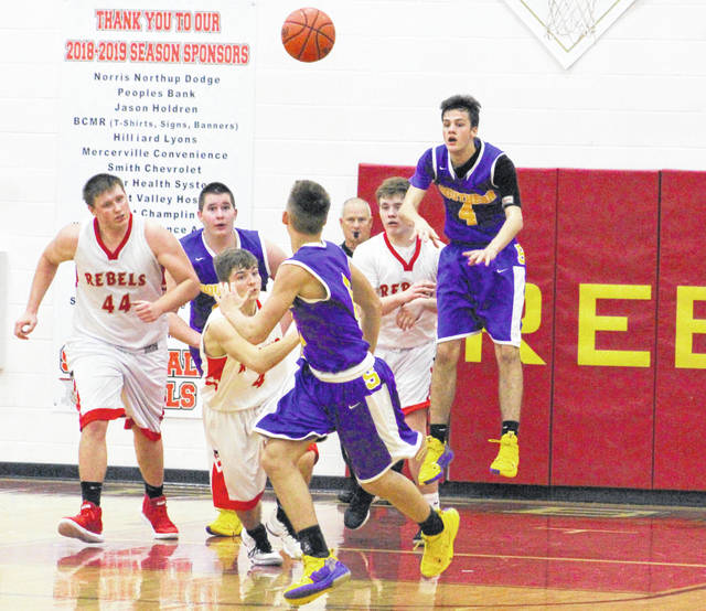 Southern senior Weston Thorla (4) makes an outlet pass to start a fast break attempt during the second half of Tuesday night's boys basketball contest against South Gallia in Mercerville, Ohio.