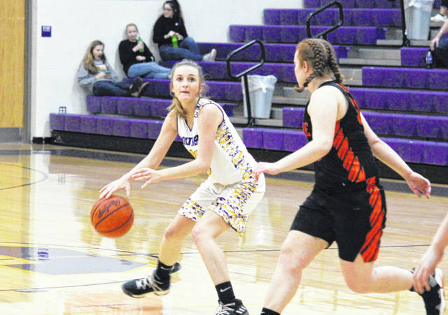 Southern sophomore Jordan Hardwick dribbles near the top of the key, during the Lady Tornadoes' 58-50 setback on Wednesday in Racine, Ohio.