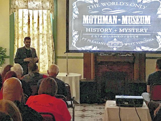 "Filmmaker Seth Breedlove addresses the audience prior to a screening of ""The Mothman of Point Pleasant"" in 2017, held at the Lowe Hotel in Point Pleasant."
