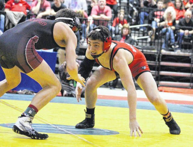 Point Pleasant freshman Derek Raike, right, stares down an opponent during the 120-pound Class AA-A state final held on Saturday, Feb. 23, at Big Sandy Superstore Arena in Huntington, W.Va.