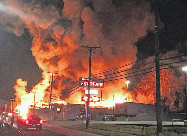 Seventy firefighters from five departments, along with other first responders, were on the scene of a large commercial fire at the former Midwest Steel/Mountaineer Metals building on East Main Street Saturday night and Sunday.