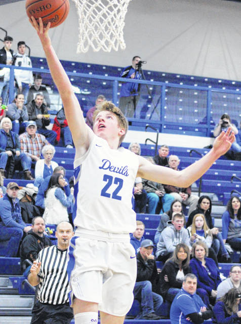 Gallia Academy senior Cory Call (22) releases a shot attempt during the second half of a Division II sectional basketball game against River Valley at Southeastern High School in Londonderry, Ohio.
