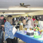 Sell out crowd attends Chamber auction, dinner