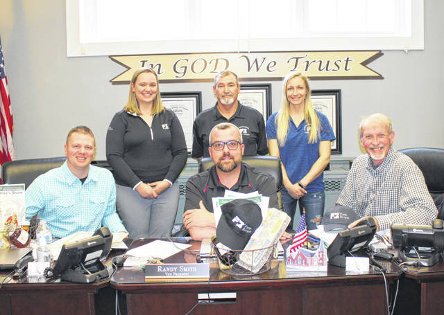 Faarm Bureau members Ashley Castor, Buddy Ervin and Alyssa Webb are pictured with commissioners Jimmy Will, Randy Smith and Tim Ihle.