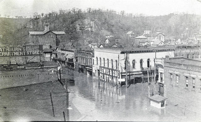 This postcard from the collection of Bob Graham shows Middleport in the January 1907 flood, looking at Mill Street and North Second Avenue. Also visible are (left to right) Rathburn's Department Stores, C. Davis & Co. Drugs, and Lewis & Coe Clothing. The text on the back of the postcard, which was mailed to California, reads: Middleport during recent high water. Photos and postcards, such as this one, from Graham's collection can be seen at the Meigs Museum or on the Meigs County Library website.