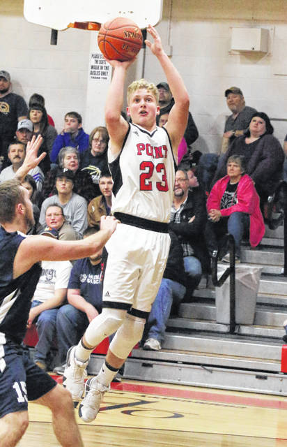 Point Pleasant sophomore Hunter Bush releases a shot attempt during the second half of a Jan. 11 boys basketball contest against Hannan at The Dungeon in Point Pleasant, W.Va.