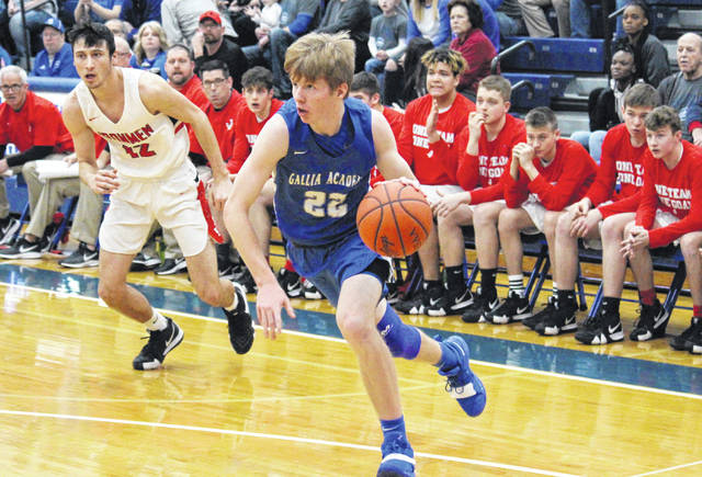 Gallia Academy senior Cory Call (22) drives to the basket, during the Division II sectional final on Feb. 23 in Londonderry, Ohio.