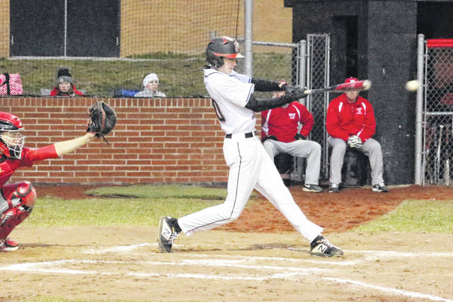 Point Pleasant senior Sam Pinkerton belts an RBI single during the second inning of Friday night's non-conference baseball game against Wahama in Point Pleasant, W.Va.