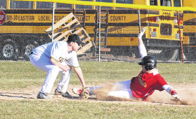 Eastern freshman Lucas Finlaw (left) applies a tag to South Gallia senior Nick Hicks (right), during the Eagles' 23-1 victory on Tuesday in Tuppers Plains, Ohio.