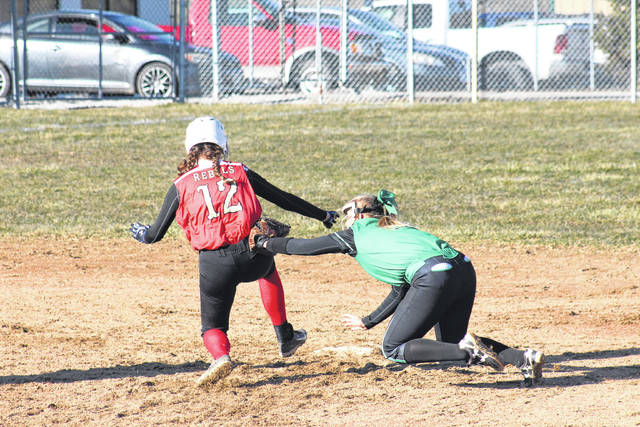 Eastern senior Cera Grueser (right) tags South Gallia freshman Chloe Payne (12) at second base, during the Lady Eagles' 11-1 victory on Tuesday in Tuppers Plains, Ohio.