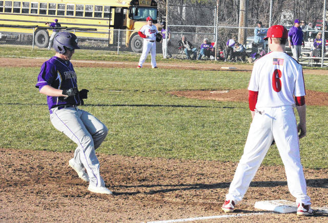 Southern freshman Will Wickline (left) steals third base in front of Wahama junior Trevor Hunt (6), during the White Falcons' 11-1 victory on Wednesday in Mason, W.Va.