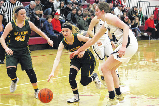 Eastern sophomore Kennadi Rockhold (center) drives in between EHS sophomore Whitney Durst (40) and NDHS senior Katie Dettwiller (right), during the Lady Titans' 10-point win on Thursday in Jackson, Ohio.