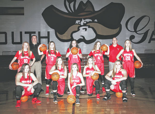 The South Gallia Jr High Girls Basketball Team finished out the 2018-2019 season with an undisputed Championship win at the Wellston 8th Grade Tournament. The girls finished regular season play with a record of 13-2. The team was made up of five 7th graders and five 8th graders, and played an 8th grade schedule all season. Team members were: 7th graders, Macie Sanders, Tori Triplett, Lindsey Wells, Emilee Bowling and Makia Miller. 8th Graders, Chanee Cremeens, Payten Halley, Natalie Swain, Ryleigh Halley and Dafney Clary. The team was coached by David Small and Mat Sanders. Pictured are Kneeling (L to R): Chanee Cremeens, Emilee Bowling, Lindsey Wells, Payten Halley and Ryleigh Halley; Standing (L to R): Dafney Clary, Coach David Small, Tori Triplett, Makia Miller, Macie Sanders, Coach Mat Sanders and Natalie Swain.