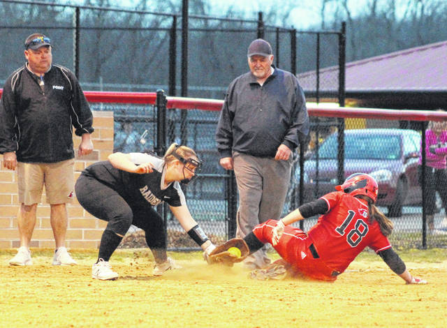 River Valley junior Kaylee Tucker (4) applies a tag to Point Pleasant freshman Emma Harbour (18) at third base during the fourth inning of Thursday night's softball contest in Point Pleasant, W.Va. Harbour was called safe on the play.