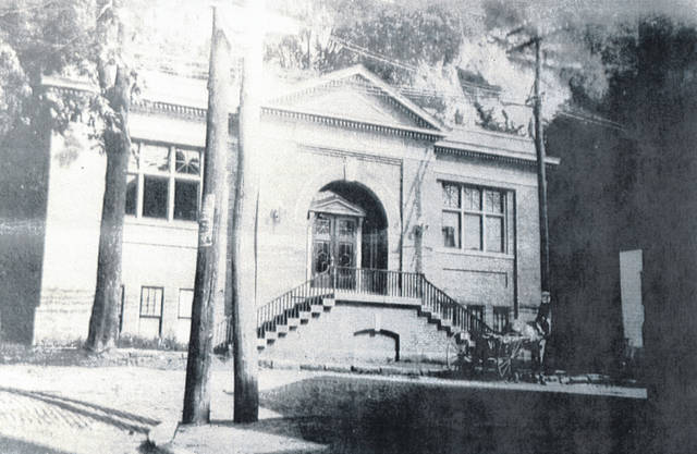 "The Pomeroy ""Carnegie"" Library, which was on Second Street in Pomeroy, is shown in this photo from the collection of Bob Graham shows the library in the early 20th century. The building is now home to the Tenoglia and Salisbury law office, while the Library has moved to its location on West Main Street. According to the Meigs County District Public Library history, the Pomeroy Carnegie Library was completed on Jan. 19, 1914. This building housed the Pomeroy Library for the next 75 years. In September 1989, the Pomeroy Library moved to its present location at 216 W. Main Street. Photos such as this one from Graham's collection may be viewed at the Meigs Museum or through the Meigs County District Public Library website."