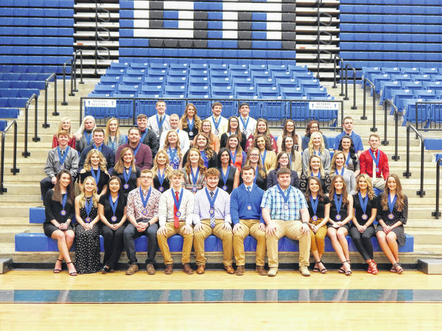 Newly inducted and veteran Gallia Academy High School National Honor Society members are, row one from left to right: Grace Montgomery, Kirsten Hesson, Katie Queen, Timothy Hill, Reece Thomas, Cade Roberts, Benjamin Cox, Brady Angel, Claire Hamilton, Brooke Johnson, Macy Jones, and Abigail Johnson. Row two from left to right: Megan Bailey, Peri Martin, Rebecca Sydenstricker, Tessa Skinner, Barbara Wright, Eliza Davies, Morgan Loveday, Bailey Meadows, and Alex Barnes. Row three from left to right: Cory Call, Clay Montgomery, Elijah Baird, Brittany Masters, Mariah Liberatore, Madalyn Williamson, Kiesla Kormanik, Cheyenne McGuire, Ashton Webb, Taylor Burnette, and Bo Saxon. Row four from left to right: Abigail Cremeans, Molly Fitzwater, Tea McCarley, Morgan Stanley, Derek Henry, Gretchen McConnell, Elizabeth Hoover, Ashley Turley, Taylor Staton, Haylee Polinsky, and Wyatt Sipple. Row five from left to right are National Honor Society Officers:Treasurer, Justin McClelland; Secretary, Katie Carpenter; Vice-President, Cole Davis; President, Lane Pullins. Not Pictured: Brett Sisson and Jenna Wood.