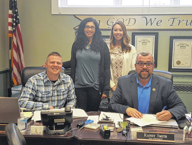 Katie Anderson (back, left) and Melanie Sheets (back, right) joined the Meigs County Commissioners on Thursday as they recognized Autism Awareness Month. Pictured (front, from left) are Commissioners Jimmy Will and Randy Smith.