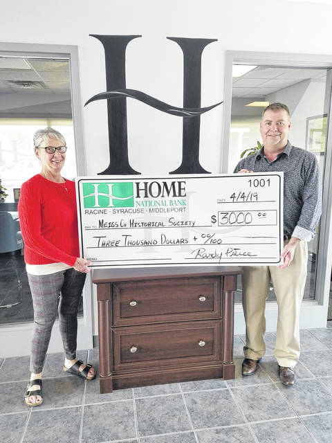 Randy Pierce of the Middleport Branch of Home National Bank recently presented a check to Vicki Hanson, director of the Meigs County Historical Society museum, as part of a three-year pledge to help with renovation work at the new museum site.