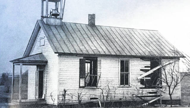 "The Carmel School, pictured in this photo from the Meigs County Historical Society, was struck by lightening on March 25, 1913. The recent Meigs County Historical Society newsletter gives an account of the event as written by Inez McNamee Radford, whose brother Ralph was injured. The account goes as follows, ""Ralph was sitting by the window and was badly injured with a big gash across the top of his head, a streak down his neck and across this shoulder. His arm had no skin from the shoulder down. His hair was all burned. He had a wool coat on and there wasn't a mark on it bit the cotton shirt sleeve underneath was in shreds. Dr. Philson said he could not live until morning but he recognized everyone that visited. He had no feeling in his arm what was injured by the other arm pained him. He complained of his left ear hurting but it was his right side that was injured. I (Inez) was outside doing laundry and Ralph came and asked me to look in his ear. I took a hairpin and got a hunk of either wood or metal from his ear. He never complained any more after that. His hair grew back very think. The experience did not seem to be make him nervous about storms after that."" Ralph was about 12 years old at the time. Other accounts of the event can be found in the Meigs County History book and in The Daily Sentinel on the 75th anniversary of the event in 1988."
