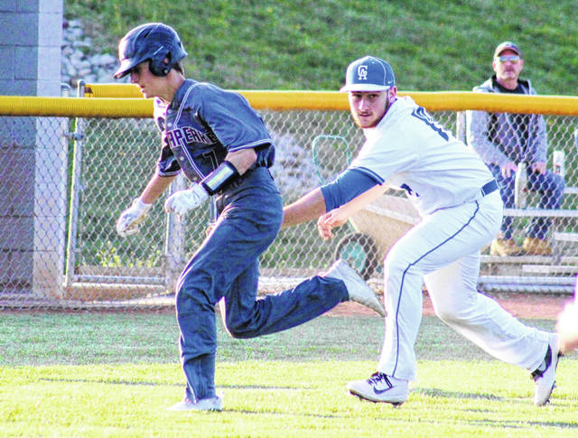 GAHS junior Cade Roberts (right) tags a Panthers runner between third and home, during Chesapeake's 2-1 win on Wednesday in Centenary, Ohio.