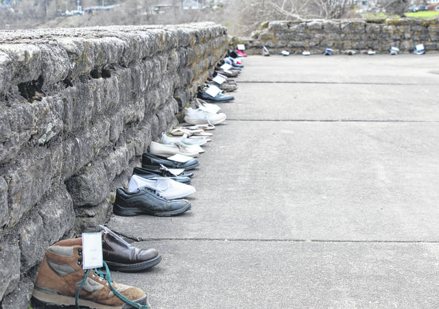 A total of 516 shoes lined the wall of the Pomeroy Parking Lot as part of the National Crime Victims' Rights Week recognition.