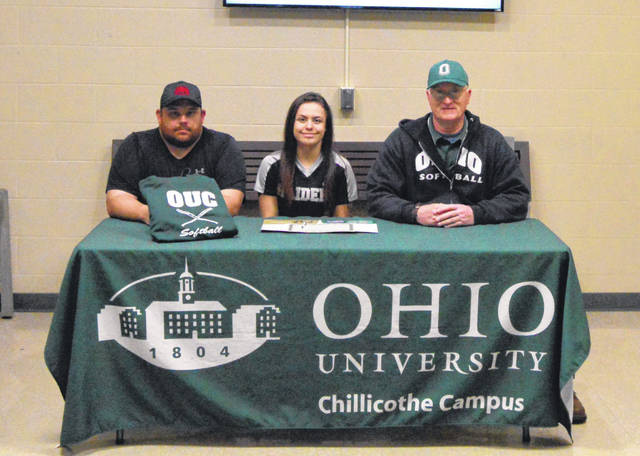 River Valley senior Cierra Roberts, seated middle, will be continuing her softball career at Ohio University Chillicothe after signing with the Hilltoppers on Monday, March 25, 2019, inside the lobby of RVHS in Bidwell, Ohio. Joining Cierra at the table are RVHS softball coach Nick Roberts, left, and OU-Chillicothe softball coach Geroge Beck.
