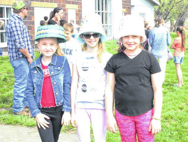 Ready for the hunt? These girls used their buckets as hats while they waited to hunt eggs.