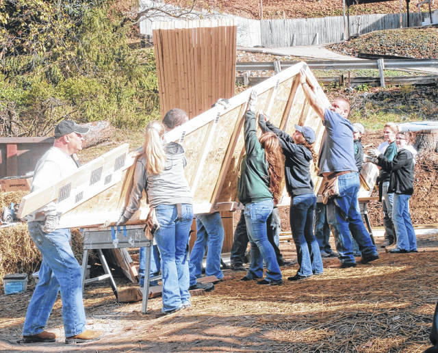 Volunteers will be on hand this weekend to work on the Blitz Build for the second Habitat for Humanity house in Middleport. Pictured here, volunteers work on the Blitz Build at the first Habitat for Humanity project in the county.