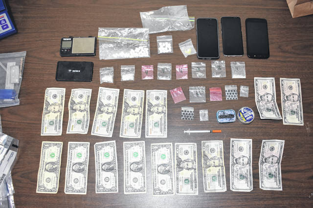 Cash, drugs and other items were reportedly found during a search warrant at a residence in Portland.