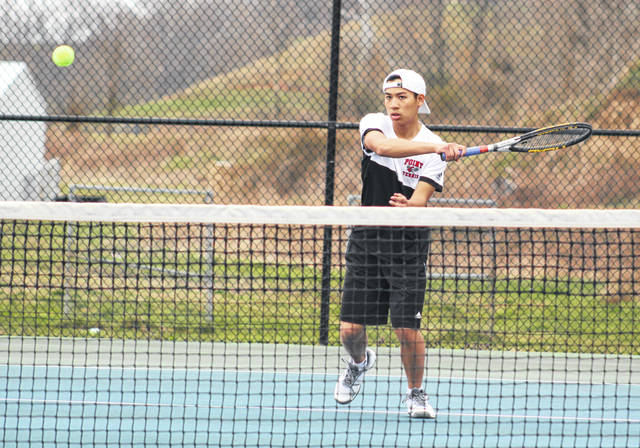 Point Pleasant junior Dylan Tayengco hits a forehand shot during Friday's second singles match against Sissonville at The Courts in Point Pleasant, W.Va.