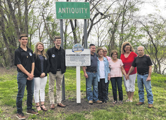 Bicentennial ambassadors Cooper Schagel, Brielle Newland and Grant Adams are pictured with members of the Shain family (right of the sign, from left) Jason Shain, SueEllen Shain, Terry Shain, Carol Reed, Roberta Shain and Dave Shain.