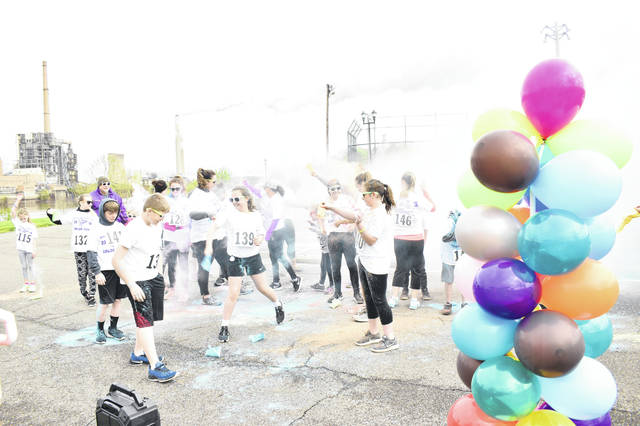 Participants received their first splash of color before beginning the race on Saturday morning.