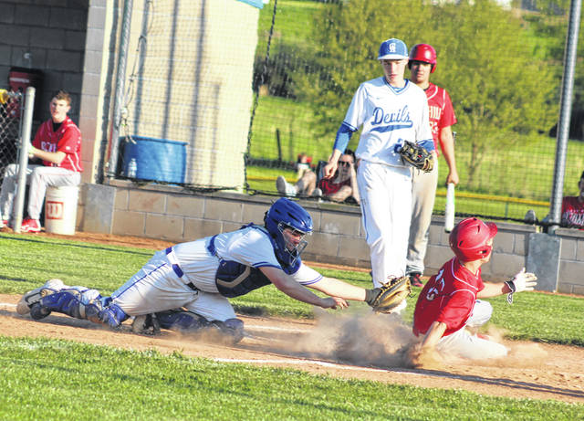 Gallia Academy catcher Morgan Stanley lunges to apply a tag during Monday night's OVC baseball contest against Rock Hill in Centenary, Ohio.