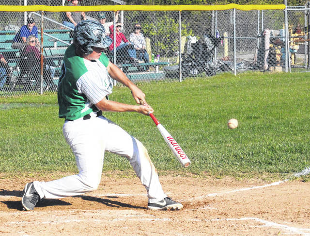 Eastern senior Nate Durst sends a pitch sailing the other way, during the Eagles' victory over Federal Hocking on Monday in Tuppers Plains, Ohio.