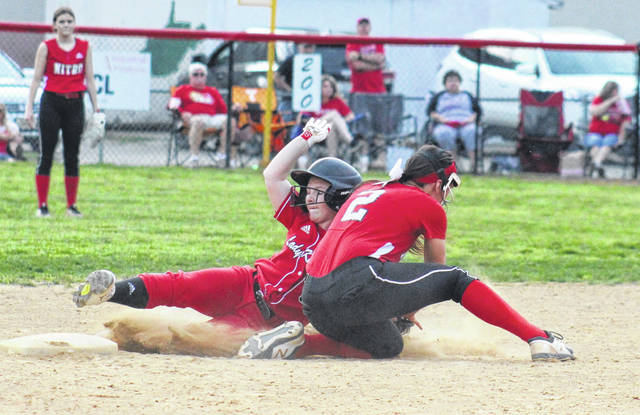 PPHS freshman Emma Sayre slides safely into second base behind Nitro's Hailey Harr (2), during the Lady Wildcats' 5-3 win on Tuesday in Point Pleasant, W.Va.