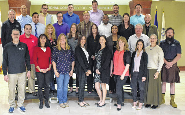 Participants in the Digital Evidence for Prosecutors program are pictured in a class photo.