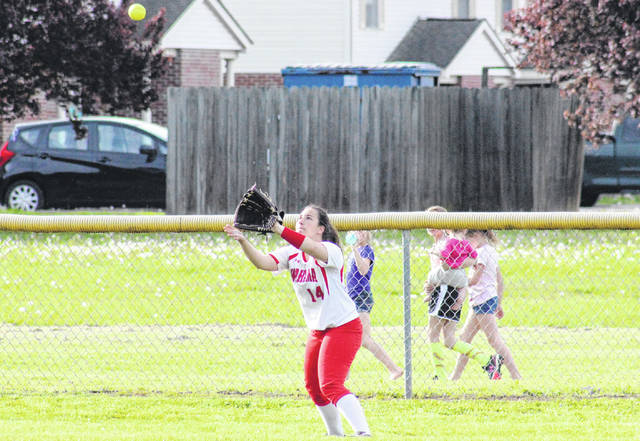 Wahama senior Emily VanMatre (14) settles under a flyball in left field, during the Lady Falcons' 10-2 victory on Wednesday in Hartford, W.Va.