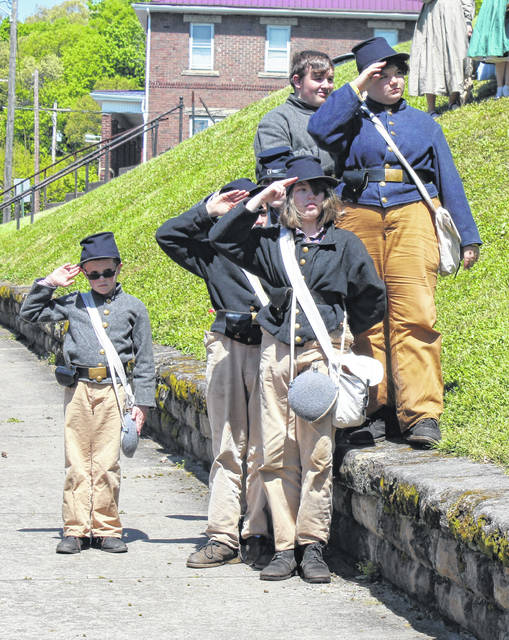 Young reenactors salute during the National Anthem on Saturday at the Meigs County Bicentennial Ceremony.