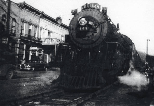 This undated photo from the Collection of Bob Graham shows Steam Engine #449 on the tracks beside Main Street in Pomeroy, Ohio. The trains stopped traveling along Main Street in Pomeroy in the mid-20th Century. According to local historian Jordan Pickens, the last scheduled Chesapeake & Ohio passenger train made the run from Columbus to Pomeroy on Dec. 31, 1949, and the final passenger boarded the train at the Rutland depot on June 2, 1951, bringing an end to passenger train service in Meigs County. During the same time, diesel locomotives began to replace steam locomotives at Hobson Yards on the New York Central Railroad (formerly Kanawha & Michigan,) and employee layoffs soon began. Graham's photos can be seen at the Meigs Museum or on the Meigs County District Public Library website.