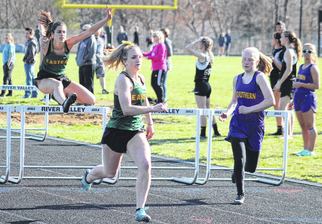 Eastern's Katlin Fick (center), Southern's Kayla Evans (right), and Eastern's Alisa Ord (left), finish first, second and third in the 100m hurdles at the River Valley Open on Tuesday in Bidwell, Ohio.
