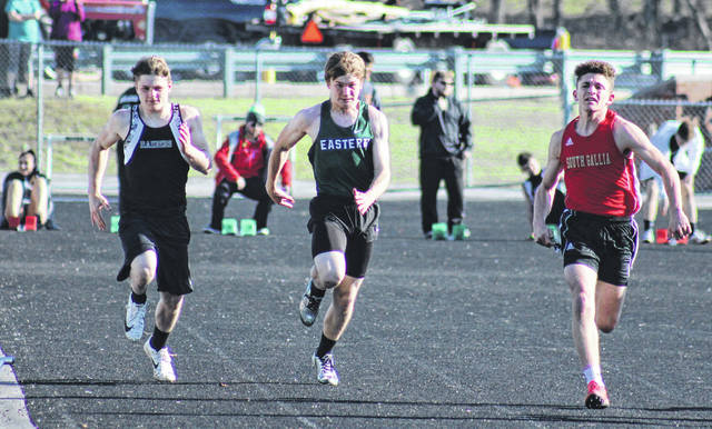 River Valley's Will Hash (left), Eastern's Jayden Evans (center), and South Gallia's Bryceton Folden (right) compete in the 100m dash, during the River Valley Open on Tuesday in Bidwell, Ohio.