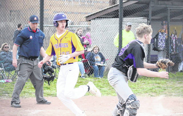 SHS senior Austin Baker crosses home plate, while Miller's catcher waits on the the ball, during the Tornadoes' 22-0 victory on Thursday in Racine, Ohio.