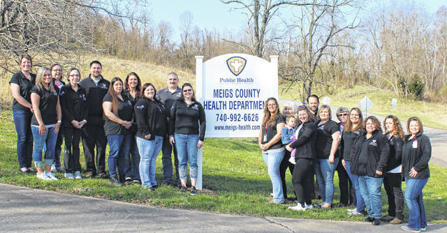 The Meigs County Health Department staff includes, (front, L to R) Shauna Chapman, Sherry Hayman, Dawn Keller, Jessica Snoke, Courtney Midkiff, Kim Casci, Jessica Howell and Roselyn, Kiera Frank, Ciara Martin, Laura Grueser, Jenna Roush, Angie Rosler; (back, L to R) Leanne Cunningham, Michelle Willard, Marc Barr, Juli Simpson, Brody Davis, Sherry Eagle, Steve Swatzel and Wilma Mansfield, MD.