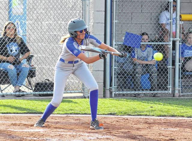 Gallia Academy freshman Abby Hammons drops down a bunt that results in a RBI single during the third inning of Monday night's OVC softball contest against Coal Grove in Centenary, Ohio.