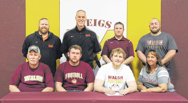 On Friday at Meigs High School, senior Claytin Neutzling signed his National Letter of Intent to join the Walsh football team. Sitting in the front row, from left, are Tim Neutzling, Coltin Neutzling, Claytin Neutzling and Lori Neutzling. Standing in the back row are Alex Saunders, Mike Bartrum, Kevin Musser and Cassady Willford.