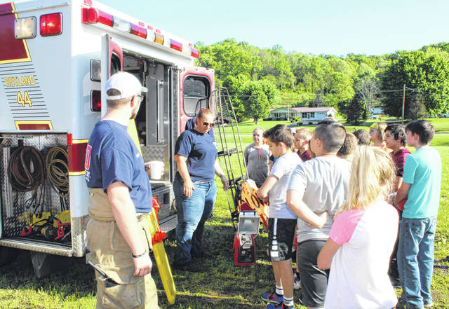 Shawna Davis and Bruce Davis from the Rutland Fire Department and Squad took part in First Responder Day at Meigs Intermediate School.