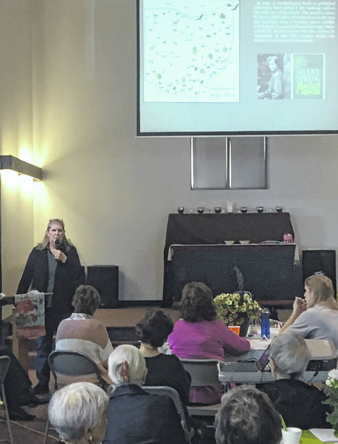 Teresa Caldwell of Athens Soil and Water Conservation District speaks during the Region 11 Garden Club meeting.
